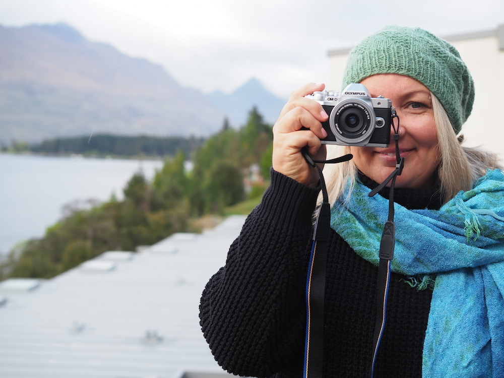 Woman using Olympus Camera at Queenstown Photography